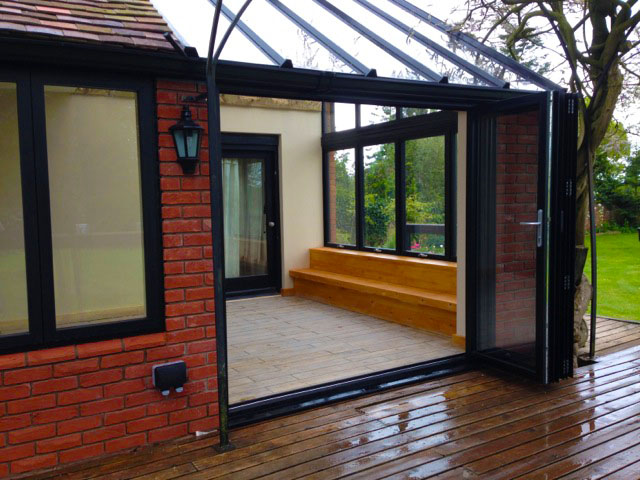 Image of the bi fold doors at the front of dounle glazed conservatory