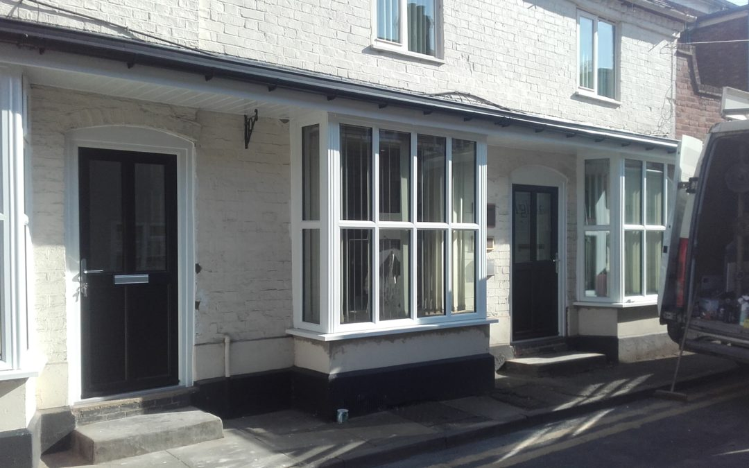 Three Bay Windows And Composite Door