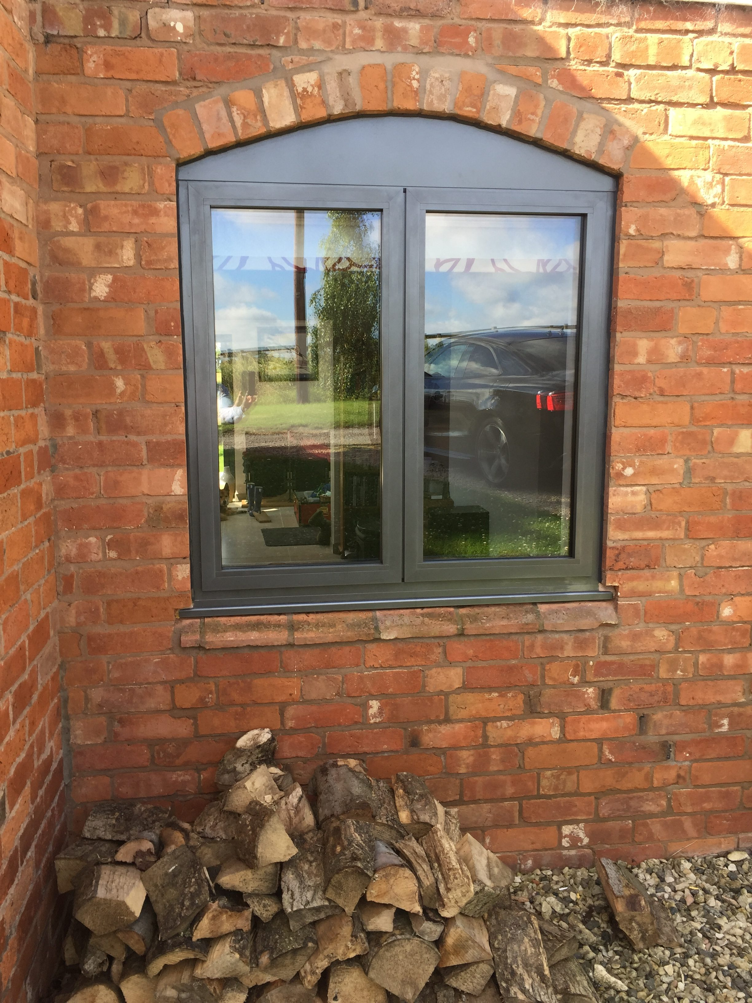 Up-close with the new Front of the lovely cottage with all new aluminium frames